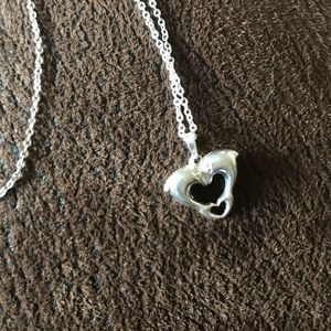 Sterling silver Dolphin heart pendant.